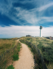 Lighthouse (Philipp Klinger Photography) Tags: light sea sky sun lighthouse house holland beach nature water netherlands grass clouds fence way landscape cross bright path dunes horizon dune north nederland vivid zee northsea crossprocessing processing gras philipp nordsee leuchtturm dne aan xprocessing noordholland niederlande egmond noord klinger egmondaanzee dcdead vanagram