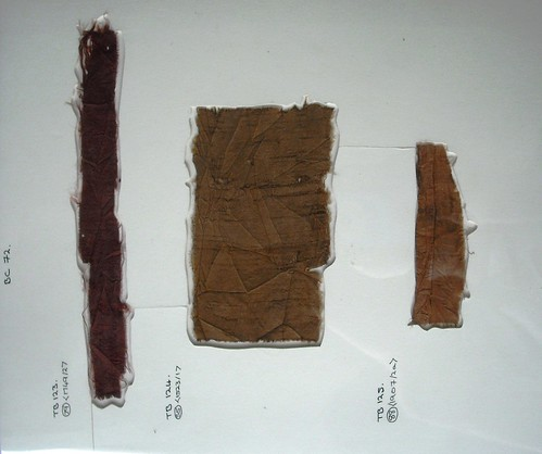 3 archaeological textiles, all shades of brown