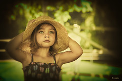 """Faith is a knowledge within the heart, beyond the reach of proof."" (Rebecca812) Tags: family portrait tree cute girl beautiful hat fence mouth outside kid eyes pretty child sweet innocent daughter lookingup g"