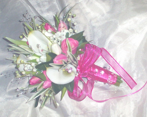 leaves pink silver gems and finished with a pretty pink bow