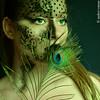 Hera (Meister Des Zirkuss) Tags: woman green girl beautiful face canon 50mm eyes paint veil feather makeup peacock filter blonde mascara facepaint mythology andrei osman hera 40d —obramaestra— magiayfotografia