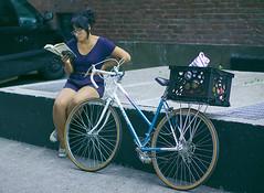 reading lolita in tehran (tomms) Tags: street toronto bike reading book sitting candid readinglolitaintehran