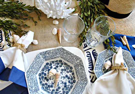beach table setting ideas+nautical rope napkin rings, shells and coral, blue and white dishes