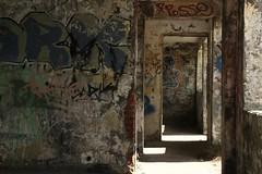 From door to door (Elly Snel) Tags: holland terschelling island graffity walls eiland bunkers muren formerum flickrchallengegroup flickrchallengewinner marjotstellingstützpunktiiihmmarjot