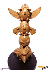 3 piggy totem pole figure