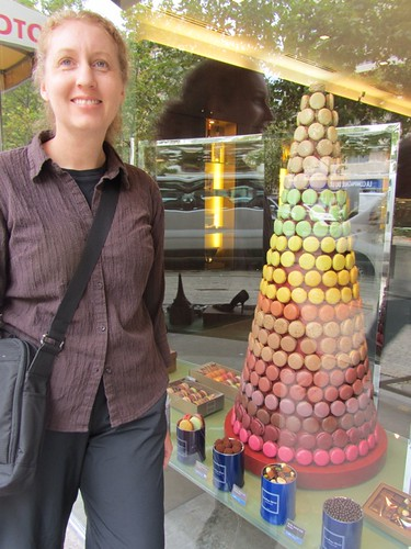 Kris next to a column of macaroons - Paris