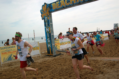 Fuzzy and Erica cross the Beachathon finish line, photo by Steve Delahoyde