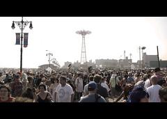 hats up. (Vitaliy P.) Tags: new york city nyc people black tower film up hat brooklyn movie island nikon bars arm bright air crowd sunny parade crop mermaid coney cinematic d80 18135mm vitaliyp