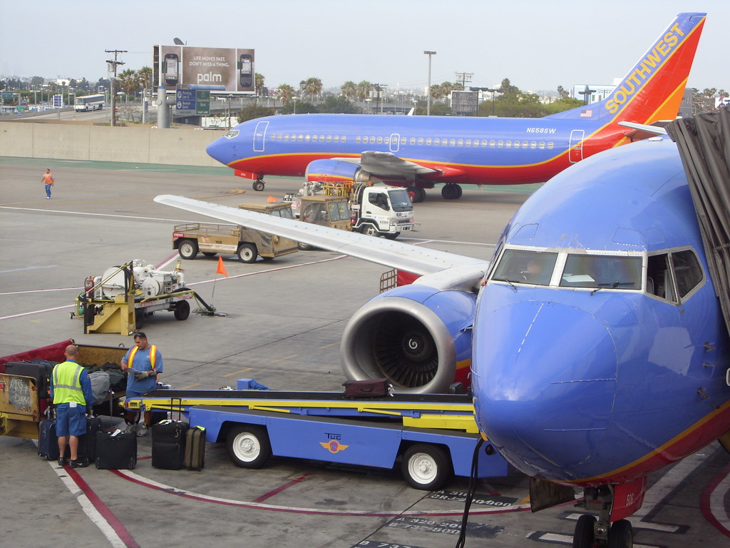 Southwest Airlines ground crew at PHX in Phoenix prepare to load the bags