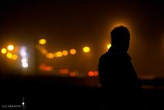 Kabuki in the Fog (Nev Charles Granum) Tags: sanfrancisco road bridge man cold silhouette fog night bay nikon highway bokeh streetlights 85mm halo windy headlights goldengate area mysterious lamps d200 damp nev tailights granum 14d observationarea
