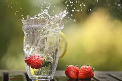 Summer splash (k4wea) Tags: summer water glass canon garden lemon strawberry bokeh strawberries summersplash shallowdepthoffield shallowdof explored t189 highestposition41 assignment52282010
