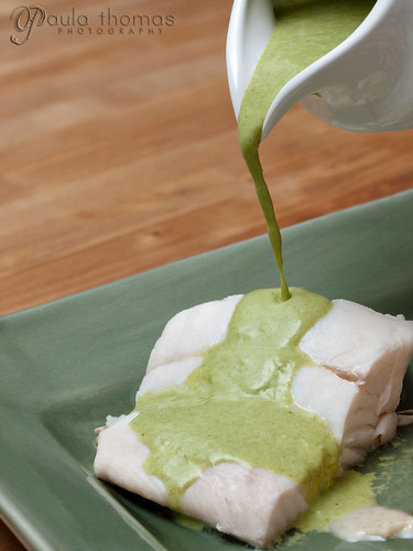 Tarragon sauce poured over poached halibut