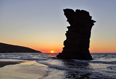 "A sunrise by the solitary rock, in ""Grias Pidima"" beach, Andros (n.pantazis) Tags: light sea sky sun reflection beach silhouette sunrise island sand waves wideangle greece legend monolith andros kx pentaxkx ormos aegeansea anawesomeshot korthi pentaxart dal1855"