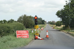 When red light shows wait here (fluffuschickus) Tags: sign trafficlight roadworks signpost redlight countrylane trafficcone roadcone waithere