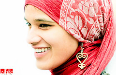 Elation (.:shk:.) Tags: portrait people music woman girl smile smiling manchester fun heart teeth muslim headscarf joy hijab streetphotography entertainment delight ethnic elation cultural glee earing shk canoneos500d shkarim sogirkarim sogskarim exodusfestival2010