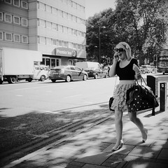 Happy-go-Lucky (Ian Brumpton) Tags: street uk england blackandwhite bw blackwhite candid streetlife ladolcevita laughter biancoenero londonist lifeinmotion sidewalkstories happygolucky londonstreetphotography scattidistrada summersmiles aimlessstrolling blackwhiteheartbeats thebiggesthandbagintheworld mobilemerriment
