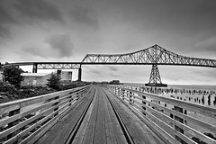 Astoria-Megler Bridge along the Astoria Trolley Line (David Gn Photography) Tags: bridge blackandwhite bw cars beach water oregon landscape outdoors pier washington automobile trolley steel under trail columbiariver transportation astoria pilings traintrack hdr megler woodenfootbridge canoneos7d sigma1020mmf35exdchsm astoriatrolleyline