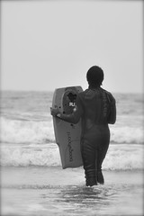 LaJolla Boogie Board (alhambramd) Tags: ocean sea summer bw cold beach water weather waves sandiego overcast lajolla beaches wetsuit boogieboard marinelayer 9090 d90project