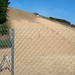 The sand dune looms