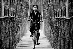Morning Commute (pearson_251) Tags: travel bridge bw woman bicycle nikon cambodia commute d80