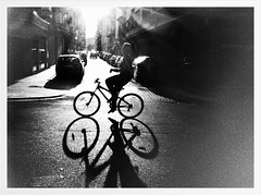 """The Shadow of a Passing Bike"" (Sion Fullana) Tags: light people urban blackandwhite espaa painterly blancoynegro beauty bike bicycle contraluz spain shadows creative"