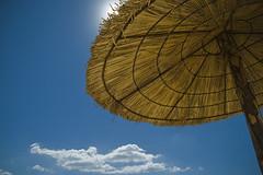 Sol y Sombra (Oscar Garca) Tags: blue sky cloud sun sol azul umbrella cielo sombrilla nube