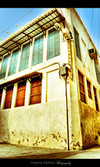 my old days are still flying over the shadows ! (HiK-world) Tags: old blue house color building history window yellow bahrain nikon shadows gulf dooor muharaq