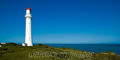 Split Point Lighthouse (whitworth images) Tags: ocean old light red sea lighthouse white building tower heritage water coast australia victoria cliffs historic coastal vic greatoceanroad navigation aireysinlet martime splitpointlighthouse