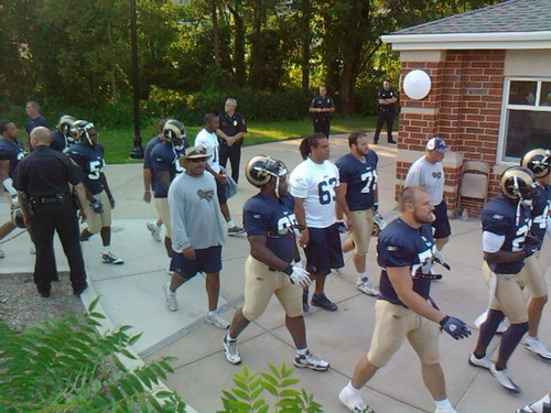 Chris Long leads a group of Rams onto Lindenwood field