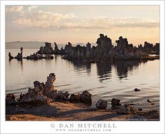 Mono Lake Shoreline and Tufa, Dawn (G Dan Mitchell) Tags: california county morning travel light sky usa lake mountains reflection nature water rock clouds sunrise landscape dawn mono shadows desert ripple towers stock smooth shoreline scenic surface hills shore northamerica tufa induro
