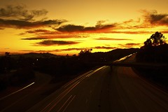 off into the sunset (Andy Kennelly) Tags: california trees sunset sky sun motion mountains cars silhouette clouds dark lights los big highway long exposure angeles silhouettes down filter lee freeway after pasadena stopper