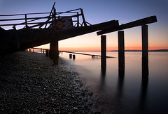 Condemned (Aaron Eakin) Tags: sunset beach water night danger pier washington condemned rocky collapse pugetsound piling hansville pointnopoint