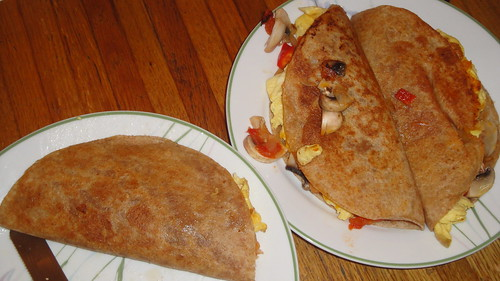 Quesadilla with sofrio, mushrooms, red bell peppers, egg omelet and Chedda cheese