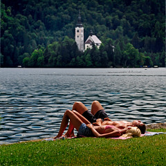 Slovenia - Lake Bled - Sunbathing sq (Darrell Godliman) Tags: travel sleeping summer vacation people copyright lake holiday travelling love tourism church nikon couple europe squares relaxing eu landmark lovers slovenia shore squareformat lakeshore bled summertime slovenija asleep relaxed sq iconic sunbathing europeanunion sunbathers allrightsreserved lakebled travelphotography julianalps cerkev europeseunie chillingout slovenien bsquare unineuropea instantfave unioneuropenne republikaslovenija omot travelphotographer flickrelite dgphotos darrellgodliman wwwdgphotoscouk savabohinjka d300s dgodliman nikond300s exposition5 pilgrimagechurchoftheassuptionofmary churchoftheassuptionofmary slovenialakebledsunbathingsq