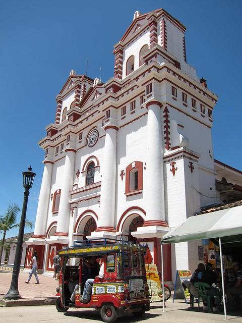 A tuk-tuk parked outside Guatape's main church.