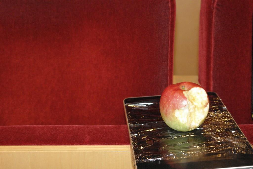 an iPad and an apple.