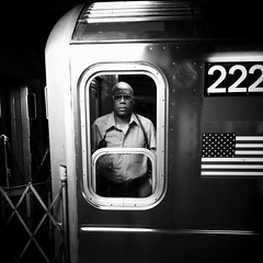 """222: Man in the Machine"" (Sion Fullana) Tags: nyc portrait people urban blackandwhite bw newyork blancoynegro sunglasses subway square eyecontact citylife streetshots streetphotography americanflag squareformat characters 222 allrightsreserved newyorkers newyorklife iphone newyorksubway lookingatyou 500x500 urbanshots urbannewyork iphone4 iphonephotography iphoneshots subwayconductor cameraapp vintbwapp iphoneography iphoneographer sionfullana editedanduploadedoniphone throughthelensofaniphone 222maninthemachine tributetoallsubwayconductorsintheworld fortheyplayagloomybutnecessarytask mobilephotogroup"