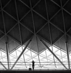 Waiting (burnsmeisterj) Tags: olympus omd em1 london lines architecture mono monochrome blackandwhite kingscross waiting train station
