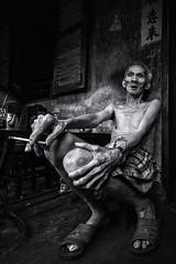 The old man with cigarette (-clicking-) Tags: streetphotography streetlife streetportrait elderly old elderlyportrait portrait oldage oldtime oldman emotion tracesoftime tracesofage tracesoflife aged smoke monochrome monotone blackandwhite blackwhite nocolors bw saigon vietnam life dailylife