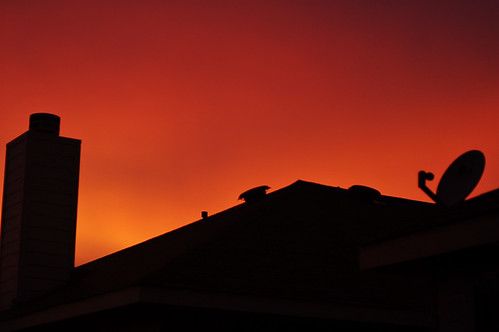 Orangey Sunset over roof of house
