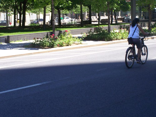 Woman on a Bixi in Victoria Square, Montreal