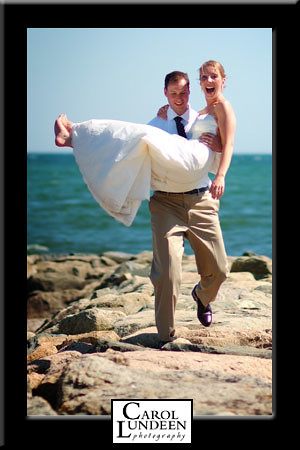 Kevin Bardon carries Laura Shannon down the jetty at the Lighthouse Inn, Cape Cod