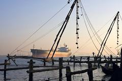 Unladen (woolyboy) Tags: light people india silhouette sunrise ship earlymorning kerala fishingnets fortkochi unladen woolyboy