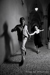 A romance in the nignt  (Bologna) (Giovanni Gori) Tags: city blackandwhite bw woman man love girl beautiful smile fashion night moving donna glamour nikon shoes couple italia moda run romance bn uomo bologna chase lightning date portici amore notte scarpe ragazza citt coppia corsa ragazzo comune cuople blackwhitephotos strobist biancoenerobw d700 flickraward littlestoriespicswithsoul nikkor2470mmf28g nikonflickraward platinumpeaceaward mygearandmepremium giovannigori