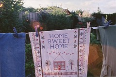 home sweet home (Adele M. Reed) Tags: light summer sun film home 35mm glare line pegs 800 washing homesweethome sunspots teatowel canoneos500n fujisuperiaxtra
