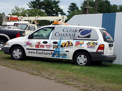 Clear Channel Radio Group Remote Van At The Northern Wisconsin State Fair. (dccradio) Tags: carnival ford festival wisconsin radio fun am fair entertainment 921 midway countrymusic wi amusements communications fordvan z100 chippewafalls sportsradio moosecountry radiovan b95 hitmusic am1400 hotcountry 1067fm remotevan hitmusicstation northernwisconsinstatefair clearchannelradio eauclaireradio thevalleysrockstation wbiz mix981 wmeqnewstalk am880