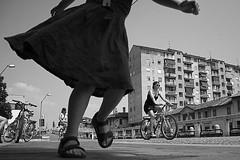 (29) (Donato Buccella / sibemolle) Tags: blackandwhite bw italy milan bike children happy milano streetphotography run naviglio lowangle fromtheground alzaianavigliogrande canon400d trezzanosulnaviglio mg3247 sibemolle 150primavere