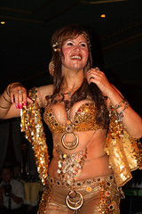 Randa Kamel - Bellydancer 8, Cairo, Egypt (Copyright Dave Halley 2010) (Dave Halley) Tags: world pictures show africa cruise smile smiling dave boats photography gold restaurant golden boat photo dance costume ship dancers dress dancing image photos stage events ships north performance egypt picture floating bellydancer dancer skirt images arabic nile east belly event photographs photograph dresses egyptian maxim shows bellydance perform arabian middle eastern bellydancing act raks skirts kamel bellydancers raqs 2010 acts halley randa sharqi sharki