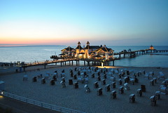 Sellin Pier at Dusk /                                                                                         Abendstimmung an der Seebrcke Sellin (chrisshots) Tags: blue sunset summer sky sun colour beach water beautiful architecture strand buildings germany deutschland lights pier fantastic nikon meer sonnenuntergang dusk tripod bluesky balticsea retro romantic omg rgen ostsee manfrotto sellin  onblue mecklenburgvorpommern strandkrbe abendstimmung seebrcke absolutearchitecture sassnitz mukran chrisshots d3000 flickraward fabulousphoto tauchglocke qualitypixels lightjunkies seenbymyeyes dblringexcellence tplringexcellence beachchairseebrcke eltringexcellence