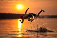 Swastika Jump (neatmummy) Tags: sunset summer sun lake swimming canon finland golden jump bokeh swastika hour f2 setting virrat splatter 135mm 135l hakaristi pirkanmaa f2l uimahyppy 5dmarkii 5d2 toisvesi